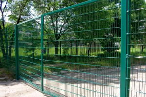 Gate from the framed welded grid
